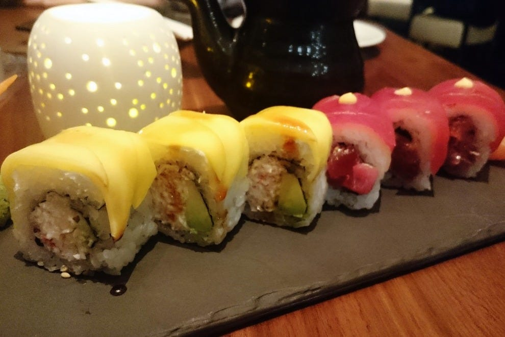 The HRGC Roll features sliced mango; the LakeHouse roll pairs tuna with melted cheese