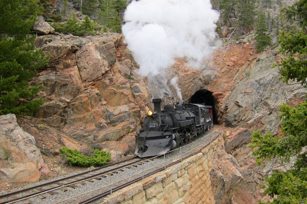 Engine 487 emerges from Rock Tunnel, aka Toltec Tunnel, at milepost 315.20, 9,276 feet in elevation