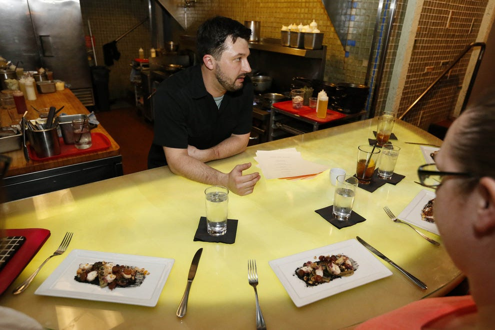 Chef Joe Tripp talks to chef's table guests at Alba