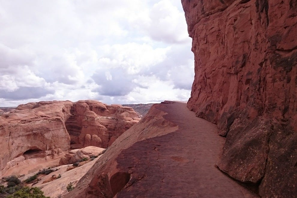 Final steps of a journey: Delicate Arch awaits just around the bend.