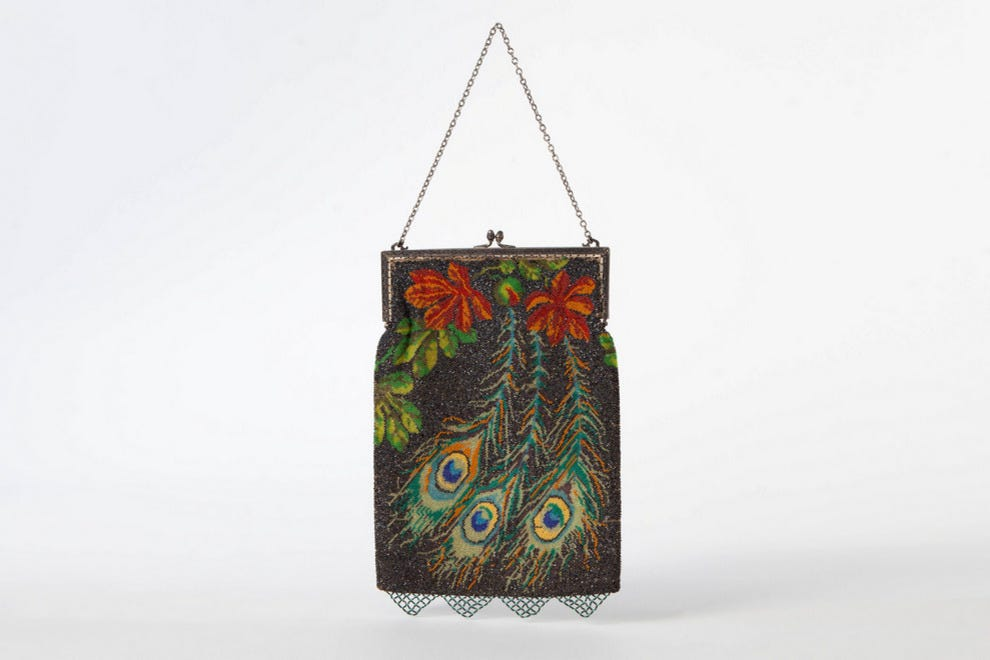 Peacock-themed evening purse with glass beadwork