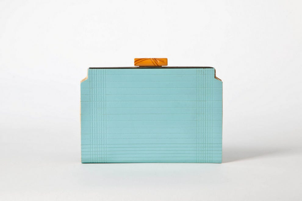 Powder blue Rodolac clutch with incised window pane design and carved wooden clasp