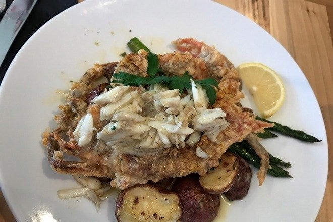Jumbo lump crabmeat gets cozy with a perfectly pan fried soft shell