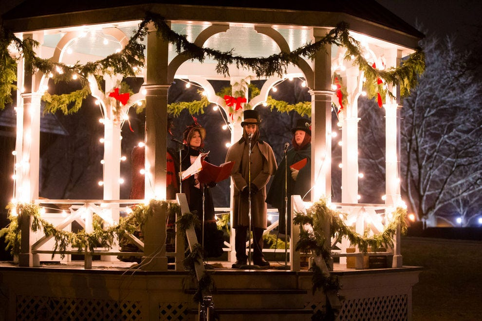 Holiday carolers add to the Christmas spirit in Greenfield Village at the Henry Ford Museum