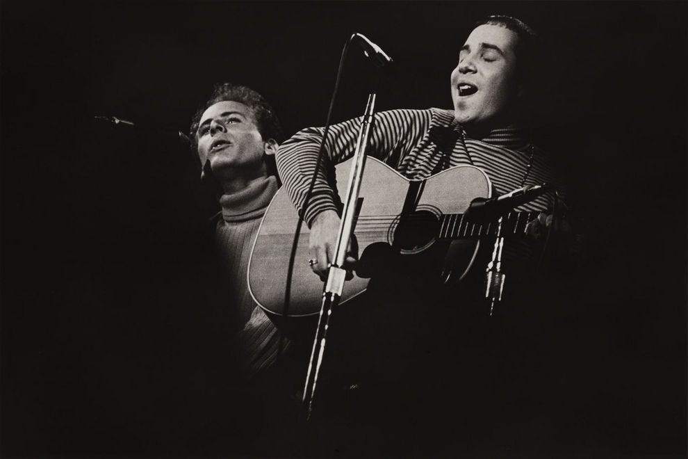 Paul Simon and Art Garfunkel performed at Monterey Pop Festival; photographer Elaine May's photos are on exhibition at San Francisco International Airport