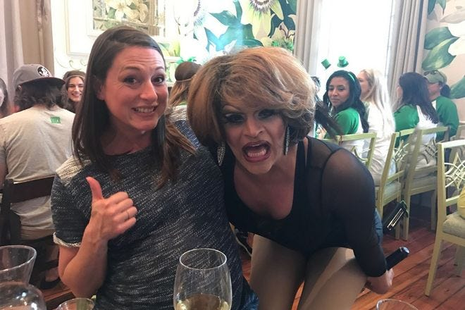 A very pregnant Sam Cusimano gives drag brunch a thumb's up.