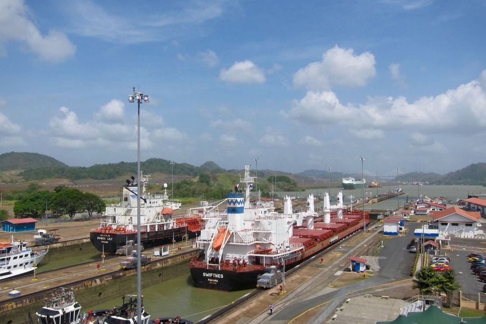 Two ships pass through the Panama Canal's Miraflores Locks, closest locks to the Pacific Ocean.