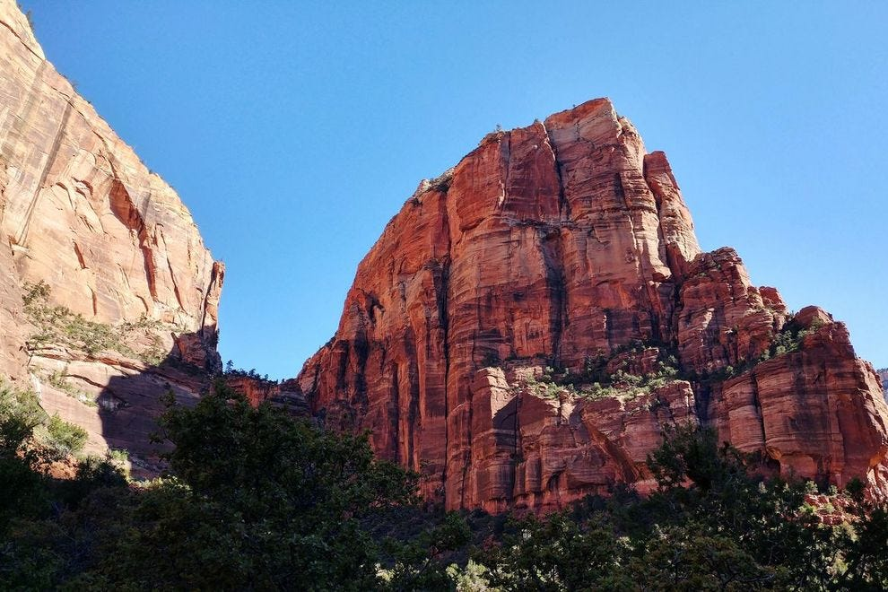 Heading out: yhe sandstone blade of Angel's Landing cuts an imposing silhouette from the base of the trail