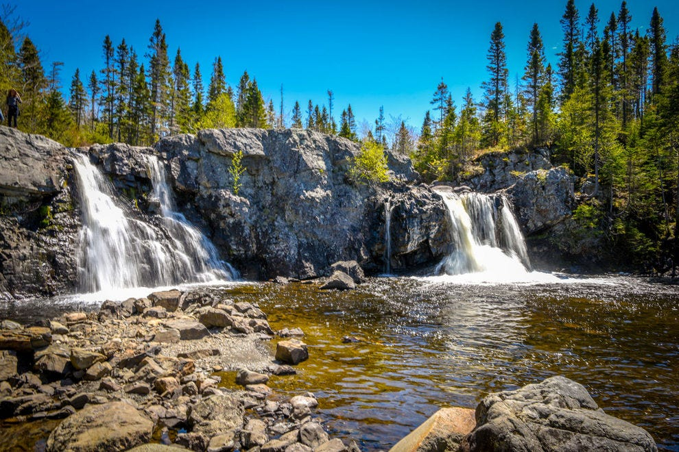 Nearby waterfalls are a popular summer swimming spot for Cox's Cove residents