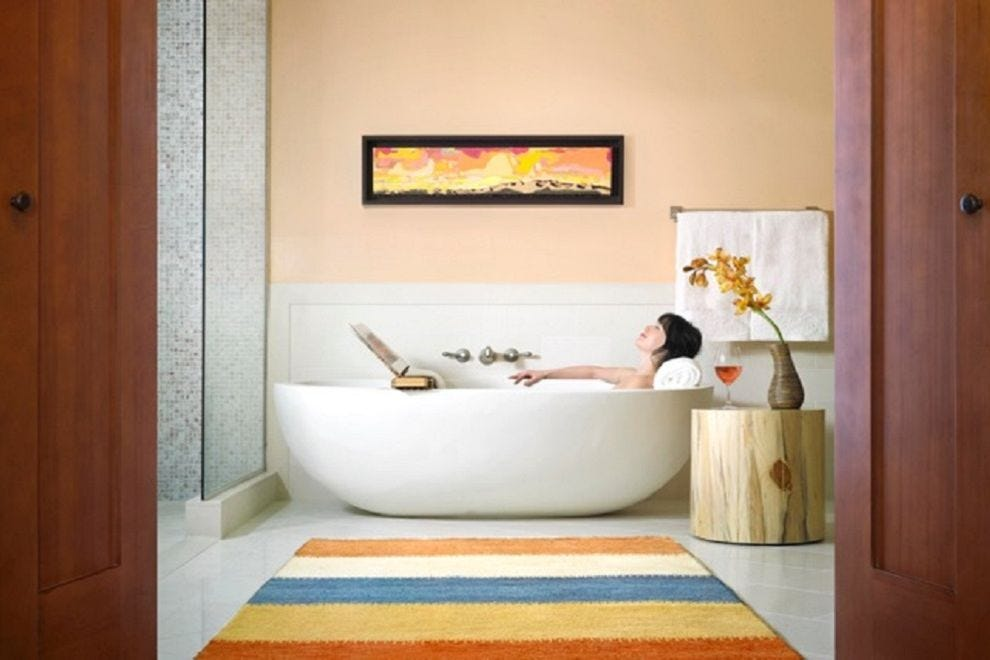 Soak in the spacious bathtub, or spread out your work and soak in the solitude of the simple lines