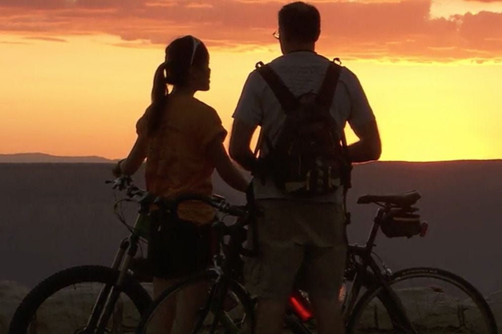 A biking couple enjoys a Grand Canyon sunset