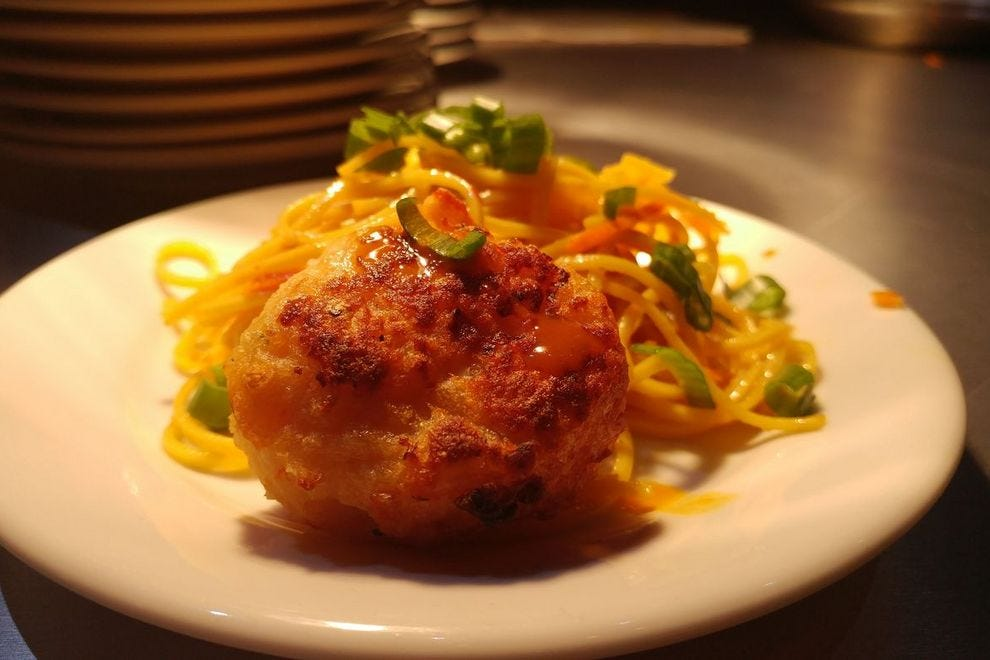 Seared shrimp and scallop cake with cold noodle salad