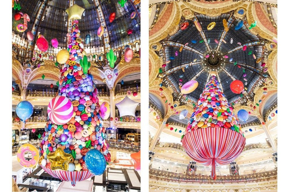 The 141-foot tree rises above Galeries Lafayette