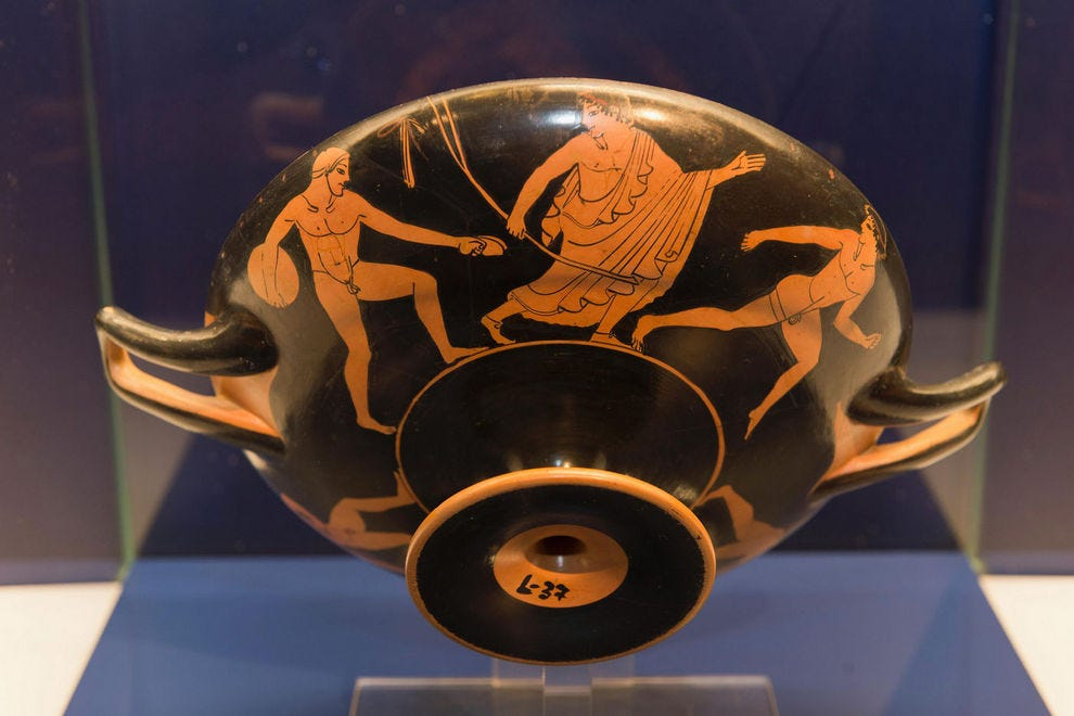 Circa 490 B.C. art depicting a discus throw, javelin and race events