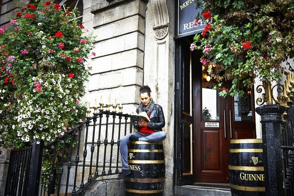 "Two things you can count on in Dublin? Beautiful flower arrangements and signs of ""Guinness"" around every bend"