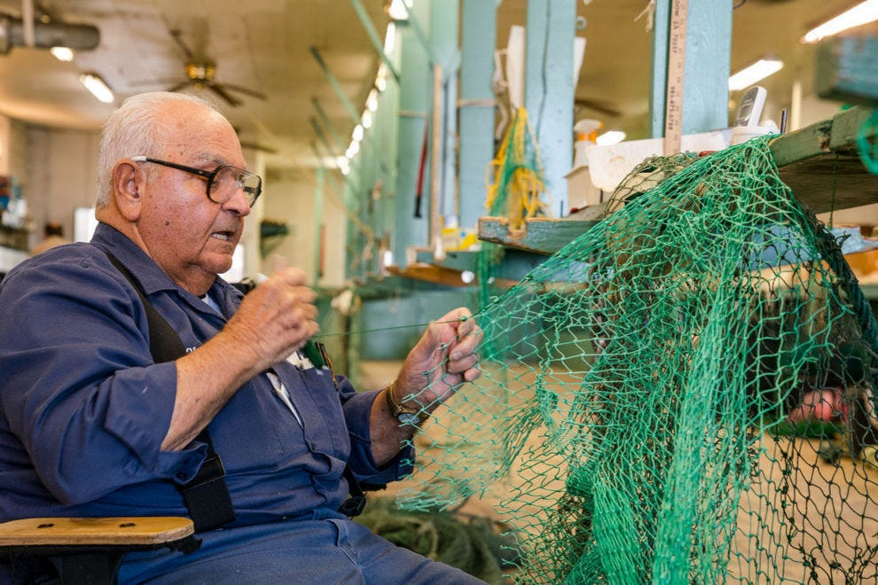 "Lawrence ""Chine"" Terrebonne at work making shrimp nets"