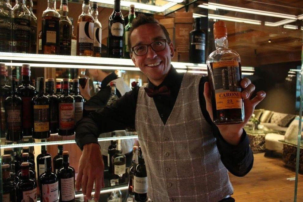 Holding a prized bottle of Caroni