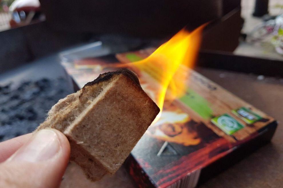 Lit fire-starter cube