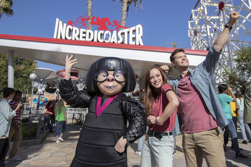 Edna Mode poses with guests at The Incredicoaster