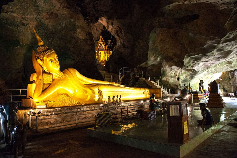 The golden reclining Buddha is the most awe-inspiring statue in Wat Suwan Kuha