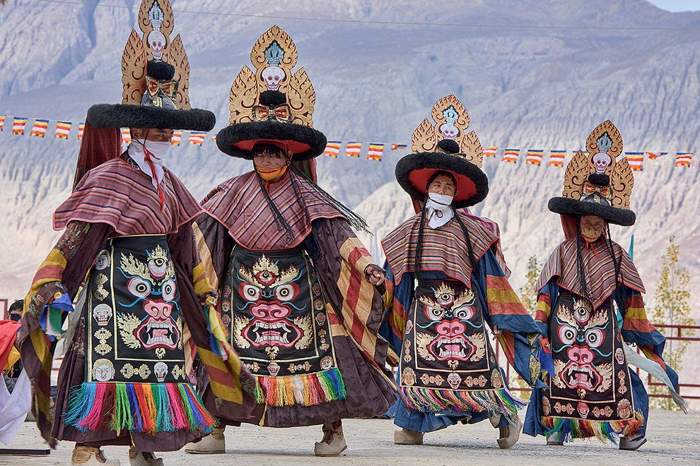 Gelugpa monks dancing at the Diskit Monastery's Gustor Festival