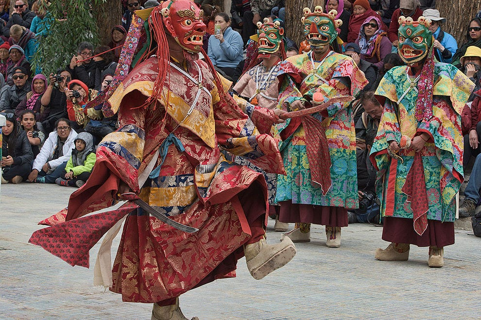 Masked monks performing at a traditional cham dance in Leh