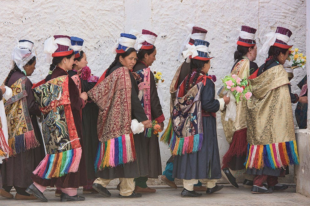 Ladakhi women in traditional dress at a Tara prayer gathering in Leh