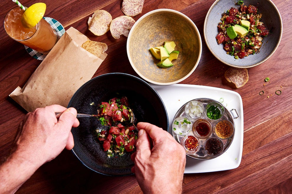 Tableside poke allows guests to customize the dish to their liking