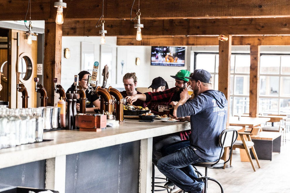 The Hatch at Tofino Resort + Marina is a waterfront pub that proves a favorite gathering space for visitors and locals alike
