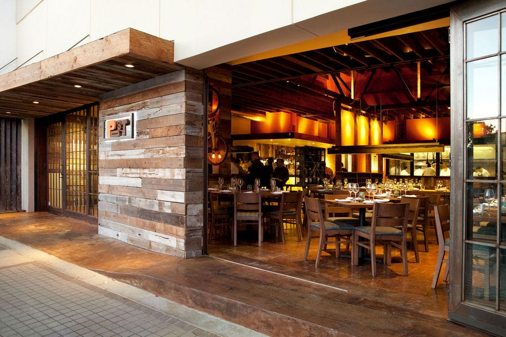 MB Post's warm, wooden exterior draws you in