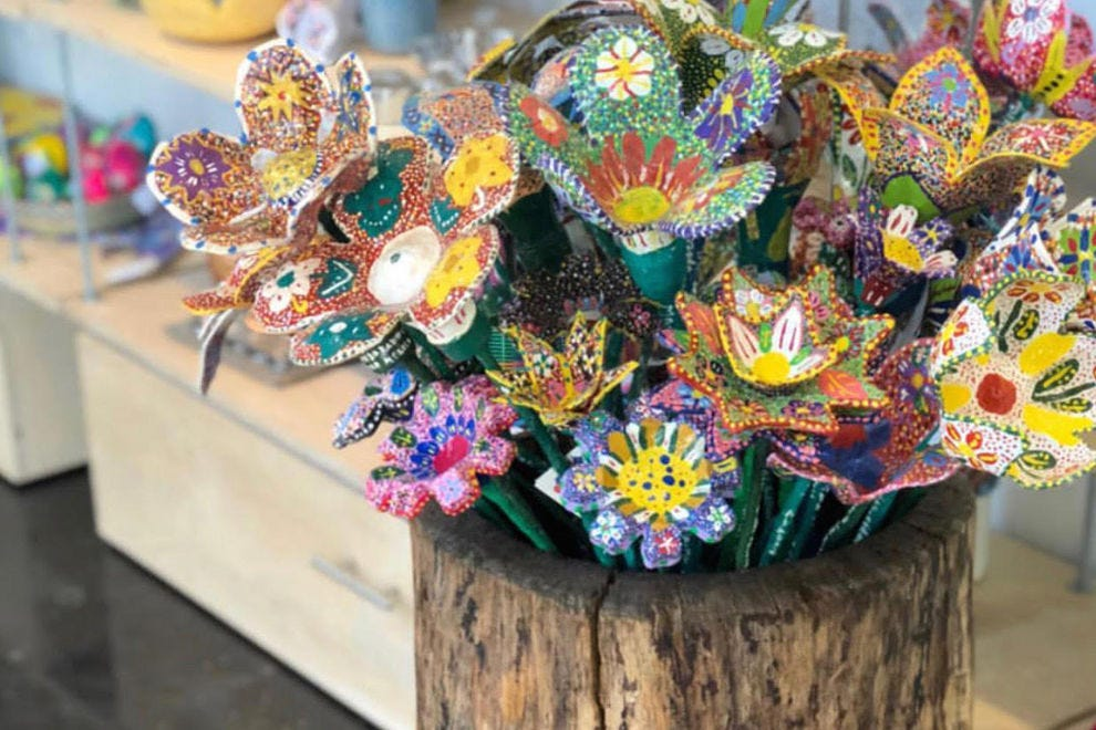 Cosas, a gorgeous new shop in The Churchill, buys these flowers made out of recycled plastic soda bottles and hand-painted by children with special needs from CITAC school in Tapalpa, Mexico, then sends a portion of proceeds back to them