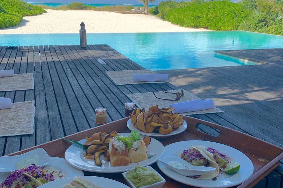 Poolside dining is always an option in the resort's private villas