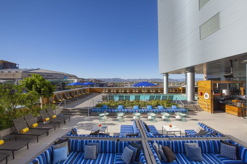 At Kimpton Hotel Palomar Phoenix, sink into ultimate bliss on the pool deck and at Lustre Bar
