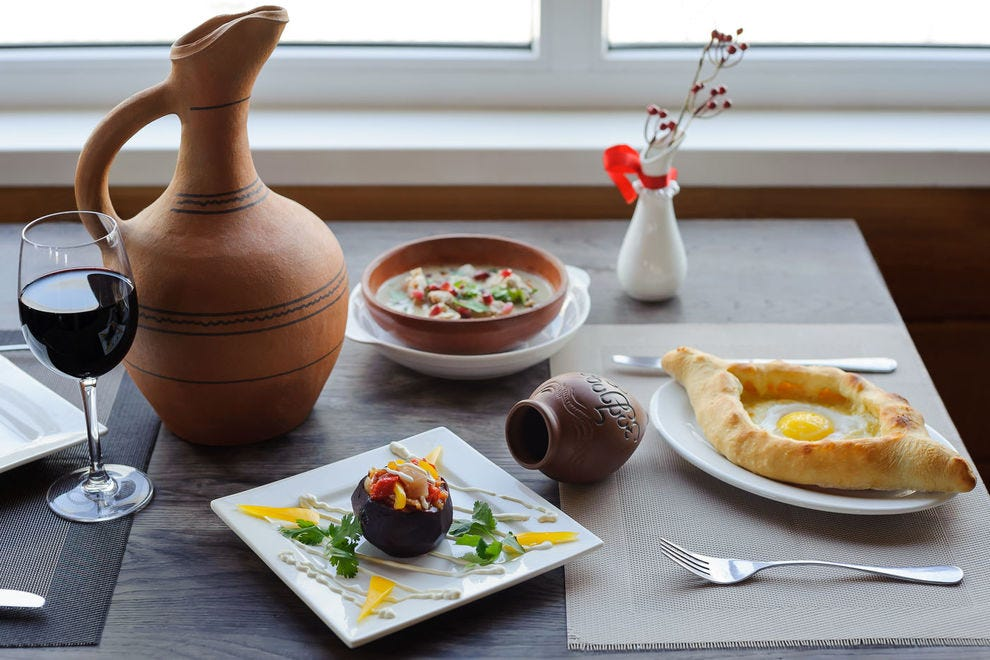 <em>Khachapuri</em>, soup and a jug of wine are typical Georgian fare