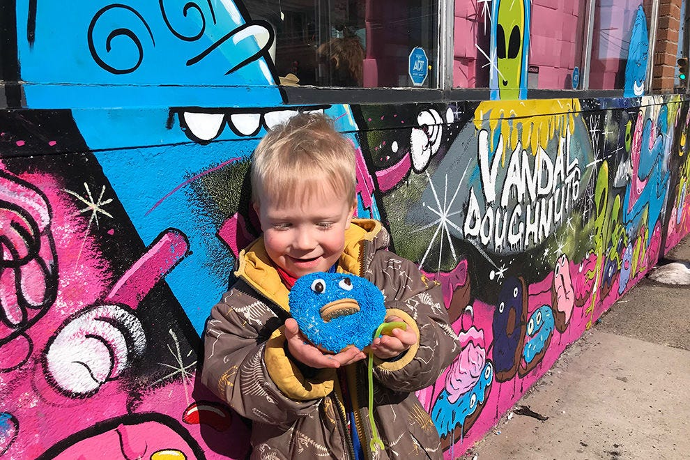 The author's son enjoying an Oreo stuffed Cookie Monster doughnut from Vandal Doughnuts