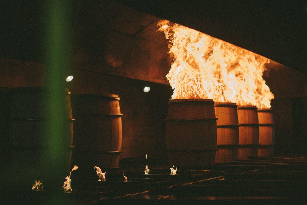New oak barrels are charred before the aging process.