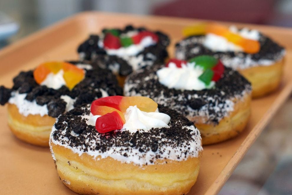 A dirt cake – Oreo crumbs and a gummy worm atop a yeast donut