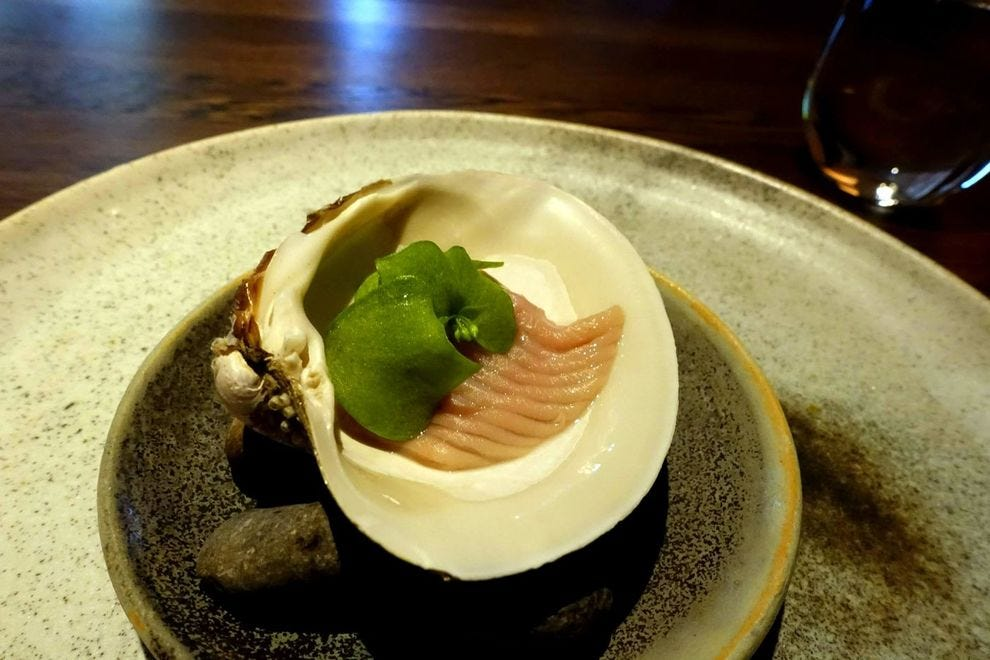 At Koks, the presentation is as impressive as the locally-sourced food, like this mahogany clam that's accompanied by a puree of kale and kelp jelly