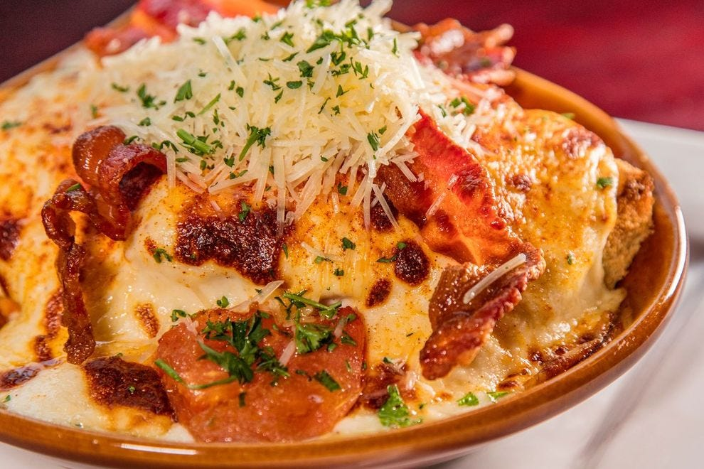 The Hot Brown consists of Texas toast, turkey, tomatoes, Mornay sauce and bacon
