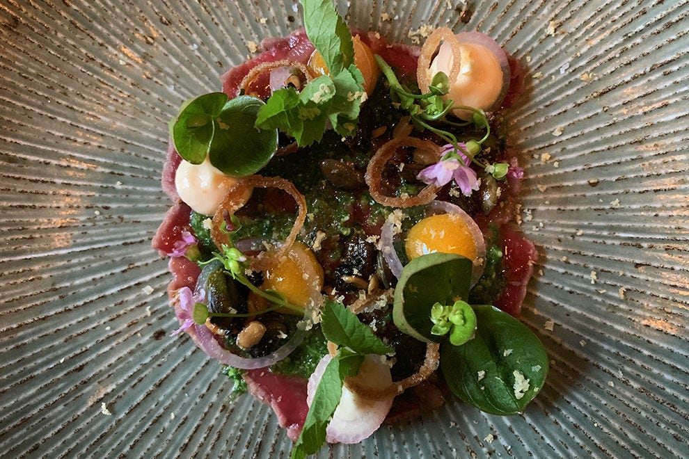 The Gannet's Hereford beef carpaccio with nut and seed granola, watercress and cheddar pesto, crispy shallot