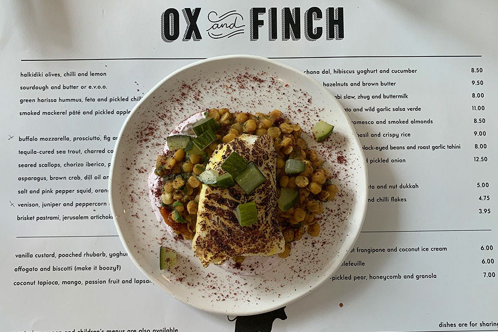 White hake on a bed of spicy chana dal with hibiscus yogurt and cucumber at Ox and Finch