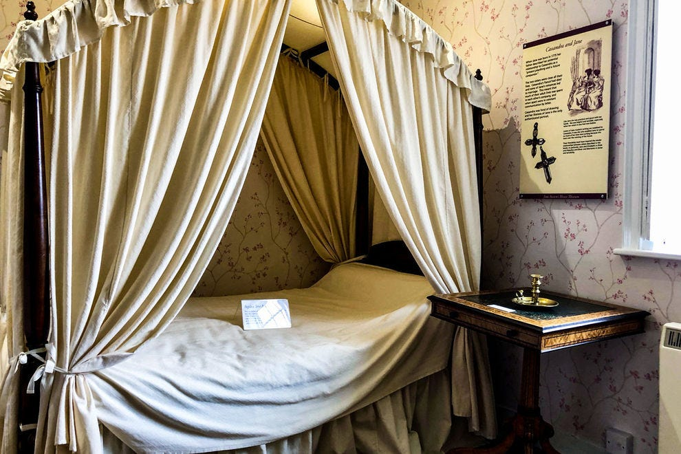 Among the displays at Jane Austen's House Museum are her room and bed, pieces of jewelry and a writing table on which she worked.