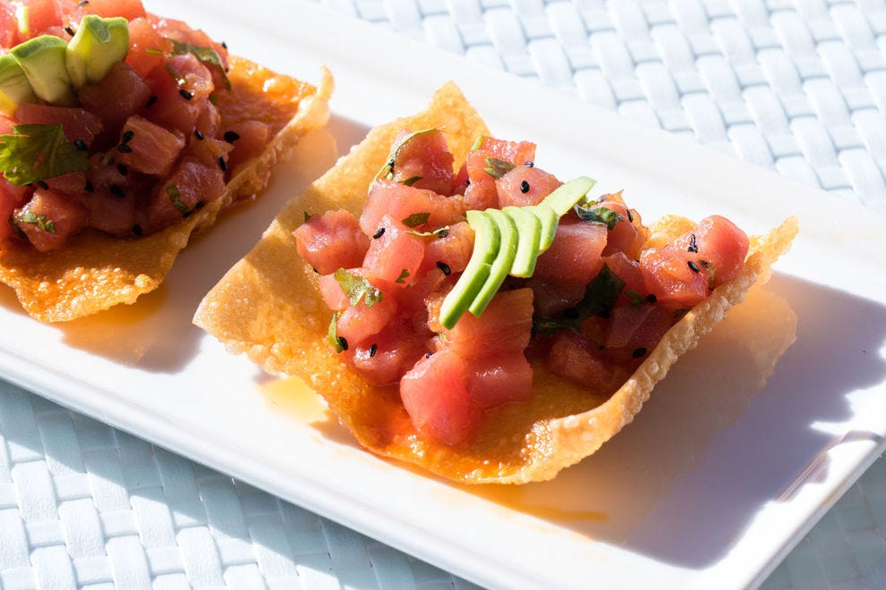 Indulge in tacos and ceviche creations featuring fresh-from-the sea delights