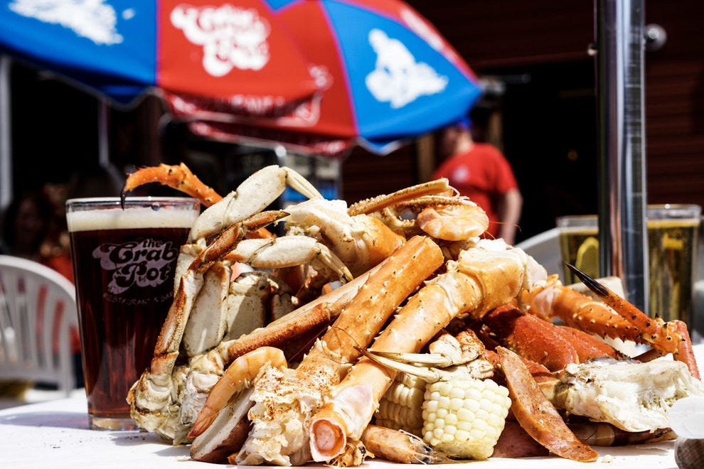Seattle diners enjoy fresh seafood at downtown waterfront spots, like The Crab Pot