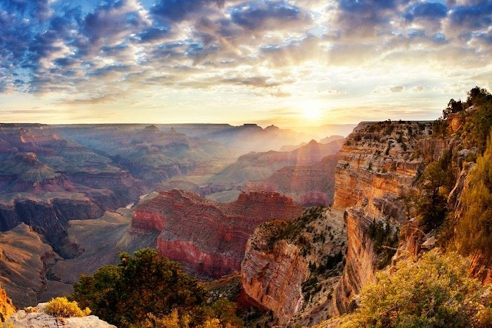 Watching the sunrise at the Grand Canyon is something to add to your bucket list