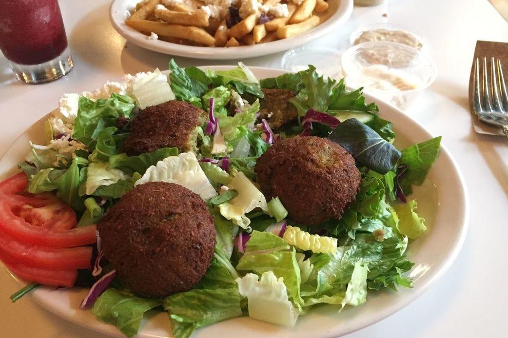 Aladdin's 15-page menu includes falafel salad, boozy slushies and Greek fries