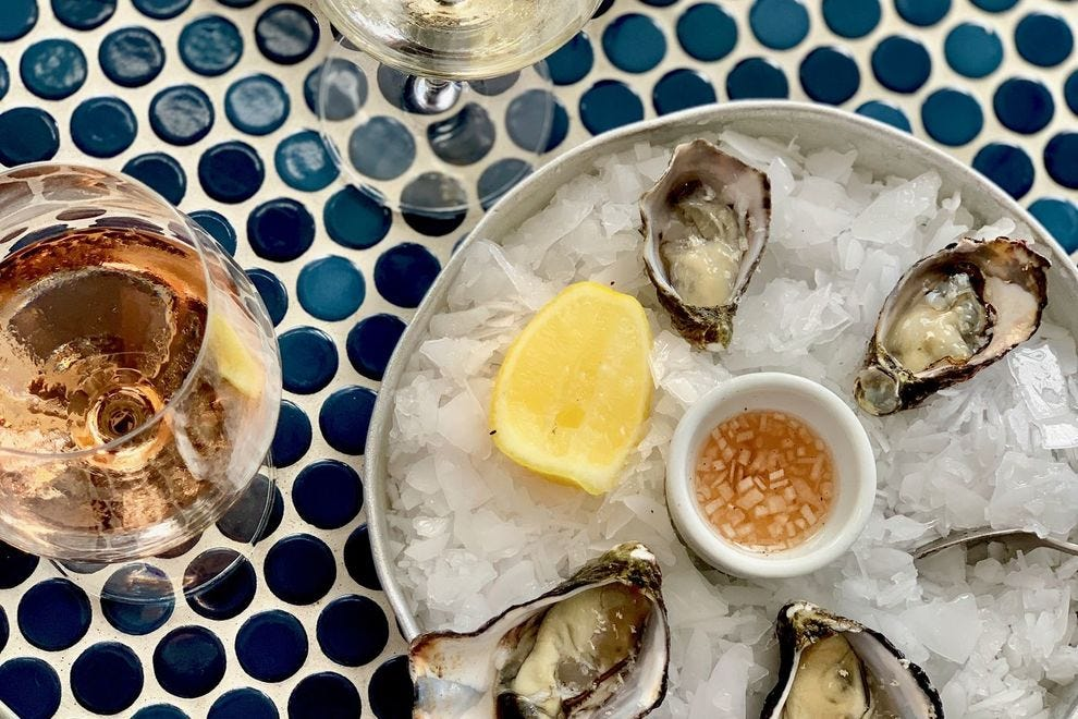 Fresh oysters at Soul, topped with zesty horseradish and accompanied by local wines