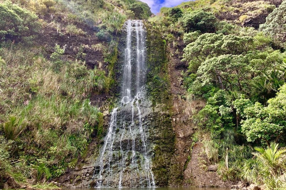 The Karekare waterfall is easily accessible for a quick stop on your way to Piha Beach