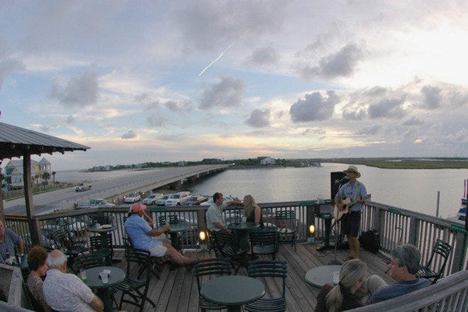 Dining on the water and live acoustic music at the Boathouse Restaurant