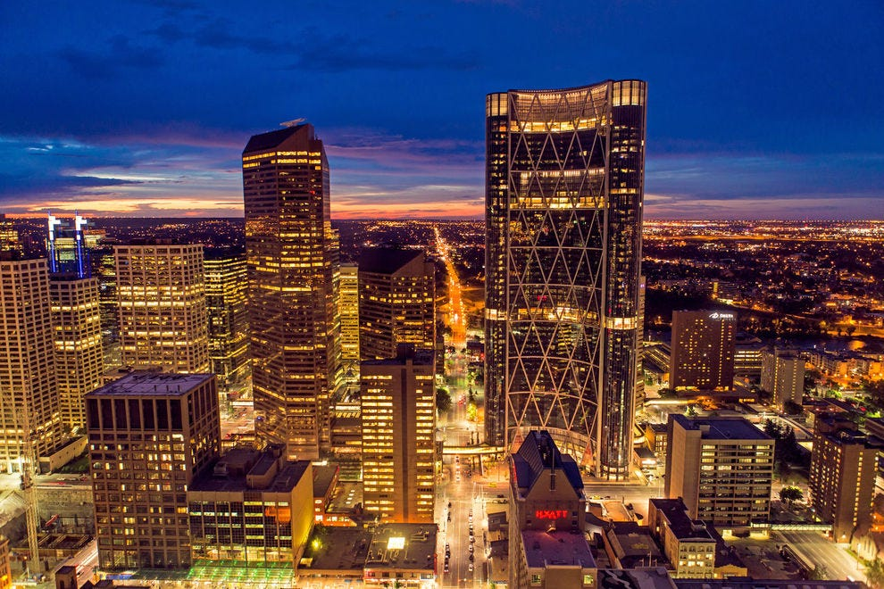 The city lights of downtown high-rises illuminate Calgary at night